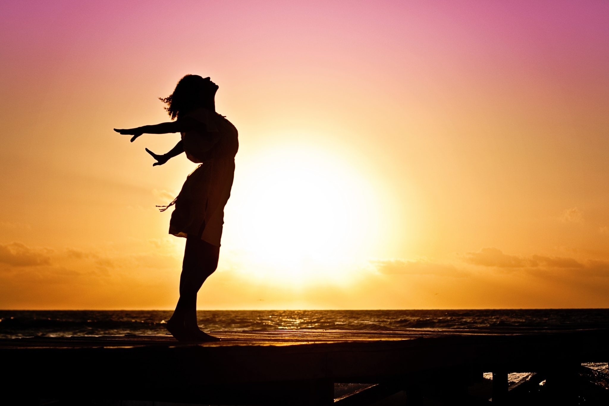 beach-woman-sunrise-silhouette-40192.jpg